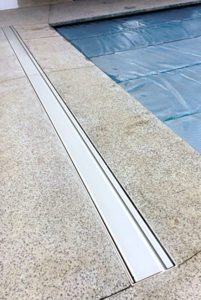 Below ground box for pool cover rollers